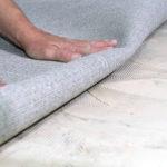 Gluing carpeting down on concrete floor